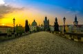 Charles bridge and old town at sunrise with its statuette the roofs of the building from in prague during the bohemia czech Royalty Free Stock Photo