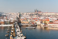 Charles Bridge and Prague Castle at winter Stock Image