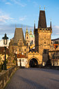 Charles bridge in prague early morning light on with st nicolas church behind tower Stock Photo