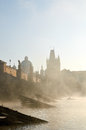 Charles bridge in prague in the morning mist Royalty Free Stock Photo