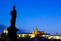 Charles bridge statue prague on castle and st vitus cathedral in the background Royalty Free Stock Images