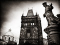 Charles Bridge tower with Church of St Francis, Prague Royalty Free Stock Images