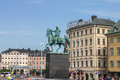 Charles xiv statue stockholm the equestrian momument to in downtown and the historical buildings of gamla stan Royalty Free Stock Images