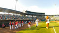 Charleston riverdogs take the field players with help some young friends before national anthem in sc Stock Images