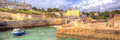 Charlestown harbour panorama near st austell cornwall england uk in creative colourful hdr panoramic view of cornish fishing Royalty Free Stock Photos