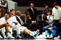 Charlotte hornets dejected bench a featuring stars larry johnson and alonzo mourning in street clothes image taken from color Stock Image