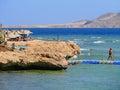 Charm el sheikh egypt november red sea coast vaca vacationers neznakomue people under umbrellas in Royalty Free Stock Photos