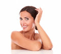 Charming adult female showing her purity head and shoulders portrait of with nude shoulders while smiling at camera on isolated Royalty Free Stock Image