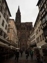 Charming alley lane road street with old traditional houses buildings at Strasbourg Notre Dame cathedral Alsace France Royalty Free Stock Photo