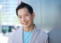 Charming asian man smiling outdoors Royalty Free Stock Photo