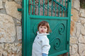 The charming boy near to a garden gate Stock Images