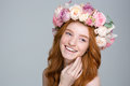 Charming cheerful woman with red hair in beautiful flower wreath Royalty Free Stock Photo