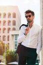 Charming and fashionable young man with sunglasses Royalty Free Stock Photo