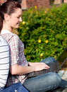 Charming female student using a laptop bo Stock Photo