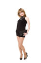 Charming girl in a black short dress isolated on white background Stock Photos