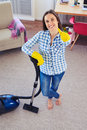 Charming girl holding vacuum cleaner and showing clearness of ca Royalty Free Stock Photo