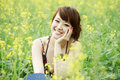 Charming girl in rape field Royalty Free Stock Image