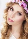 Charming girl in wreath of flowers beauty Royalty Free Stock Photography