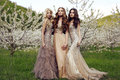 Charming girls in luxurious sequin dresses posing in blossom garden fashion outdoor photo of beautiful spring Royalty Free Stock Images