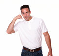 Charming guy standing with talking gesture portrait of a on white t shirt while is looking at you on isolated studio Royalty Free Stock Photo