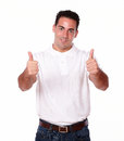 Charming hispanic guy with positive sign portrait of a standing and smiling at you on isolated studio Stock Photography