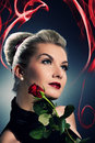 Charming lady with red rose Royalty Free Stock Images