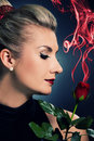 Charming lady with red rose Stock Image