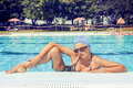 Charming lady in swimsuit posing by the poolside Royalty Free Stock Photo