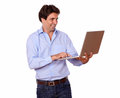 Charming latin man working on laptop portrait of a while standing white background Royalty Free Stock Photo