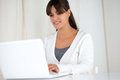 Charming latin young woman using her laptop portrait of a Stock Images