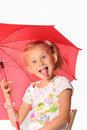 The charming little girl with red umbrella Stock Images