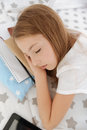 Charming little girl sleeping after working hard Royalty Free Stock Photo