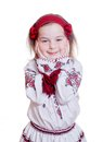 The charming little girl in the ukrainian national suit home studio it is my daughter Stock Photo