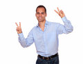 Charming man smiling and showing you victory sign portrait of a against white background Stock Photo