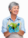 Charming old gardener holding a plant in her hand Royalty Free Stock Photos