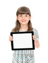 Charming pretty little girl holding up modern digital tablet her hands blank white screen isolated white Stock Photos
