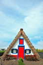 Charming rural house. A house with a thatched gable roof. Adorn Royalty Free Stock Photo