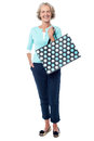 Charming senior lady with shopping bag Royalty Free Stock Photo