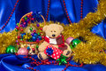 Charming small teddy bear with Christmas gift Royalty Free Stock Photo