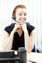 Charming smiling woman with a headset Stock Photos