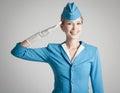 Charming Stewardess In Blue Uniform On Gray Background