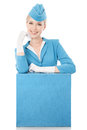 Charming stewardess in blue uniform and suitcase on whit dressed white background Royalty Free Stock Photography