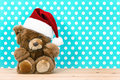 Charming vintage teddy bear with santa ha hat christmas decoration retro style picture Royalty Free Stock Image