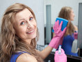 Charming woman cleaning a bathroom's mirror Stock Image