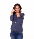 Charming woman gesturing call me sign portrait of a while pointing at you on white background Stock Photos