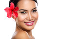 Charming woman with hibiscus flower Royalty Free Stock Photo