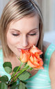 Charming woman smelling roses Stock Photo