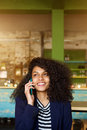 Charming woman talking on mobile phone call in cafe Royalty Free Stock Photo