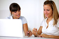 Charming young businesswomen working together Stock Photos
