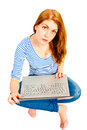 Charming young girl with a laptop on white background Royalty Free Stock Photography
